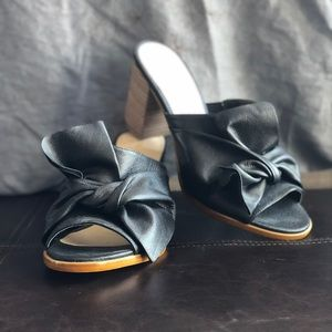 Black leather slide sandals with bow detail